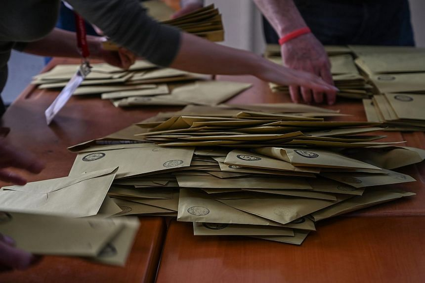 Electoral officers count ballots at a polling station in Istanbul on March 31, 2019.