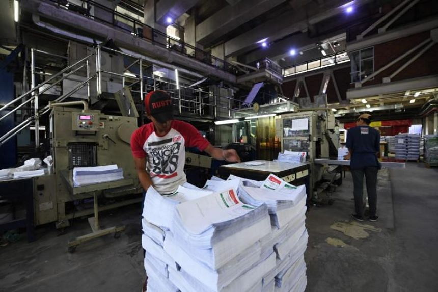 Workers stacking ballot papers at a printing press in Jakarta ahead of Indonesia's general elections, to be held on April 17, 2019.