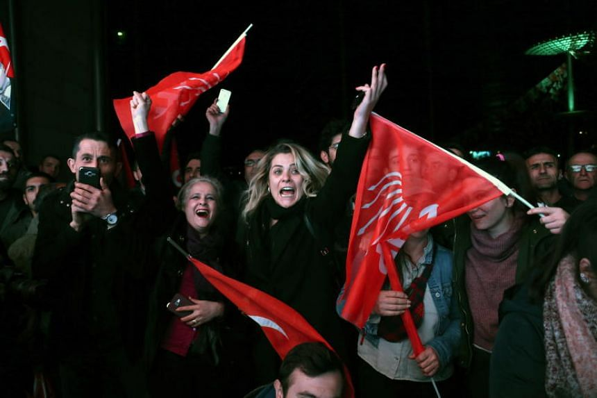 Supporters of opposition Republican People's Party (CHP) celebrate after early results for Ankara mayor in local election in Ankara, Turkey, on March 31, 2019.