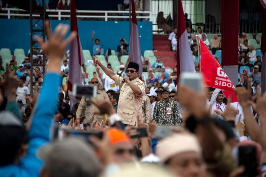 Former military general Prabowo Subianto greeting his supporters in Sidoarjo, East Java, on March 31, 2019.