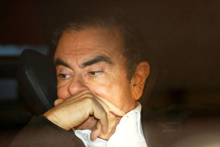 Ghosn's lawyers seek separate trial from Nissan