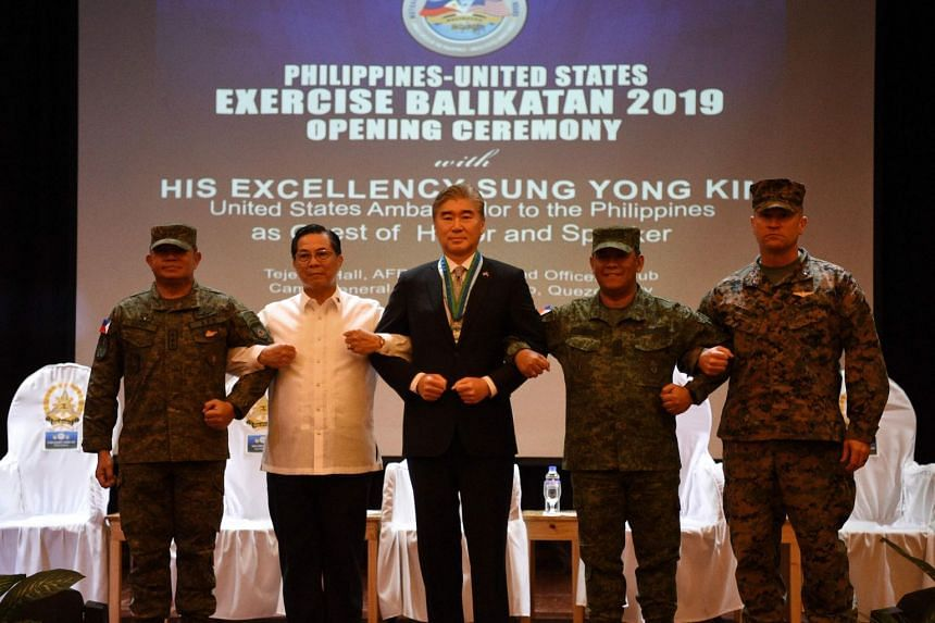 (From left) Philippines' military Lieutenant General Gilbert Gapay, co-director of the joint US-Philippine military exercise, Undersecretary Cardozo Luna of National Defense, US ambassador to the Philippines Sung Yong Kim, General Benjamin Madrigal P