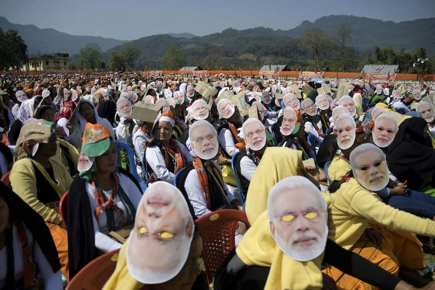 India's Bharatiya Janata Party supporters wearing Prime Minister Narendra Modi masks during a party election rally in Along in West Siang district of Arunachal Pradesh, India, last Saturday. About 900 million people are eligible to vote in election