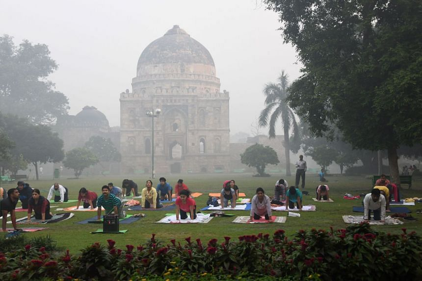 Yoga enthusiasts practising in Lodhi Gardens amid heavy smog conditions in New Delhi. According to the United Nations Environment Programme, some 92 per cent of people in the Asia-Pacific region are exposed to levels of air pollution that pose a sign