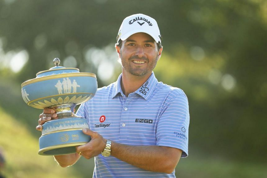 Kevin Kisner celebrates with the Walter Hagen Cup after defeating Matt Kuchar during the final round of the World Golf Championships-Dell Technologies Match Play at Austin Country Club on March 31, 2019.