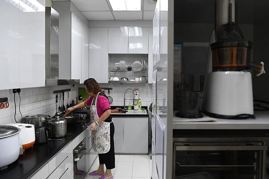Madam Lim Chow Tee, 61, is in charge of the kitchen at MapleBear's Toa Payoh North centre, and prepares meals for the pre-school. Each of MapleBear's 37 centres has a kitchen with one or two cooks.