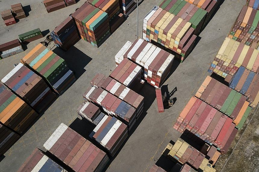 An aerial view of Tianjin Port in China. The country's manufacturing purchasing managers' index in March rose to 50.5 from 49.2, backing up signs of recovery seen in the earliest data on the economy, which showed business confidence and stock markets