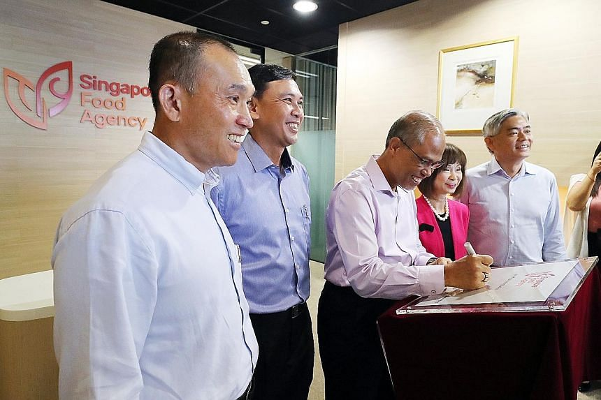 Minister for the Environment and Water Resources Masagos Zulkifli (third from left) at the launch of the new Singapore Food Agency (SFA) yesterday, with (from left) SFA chairman Lim Chuan Poh, SFA chief executive Lim Kok Thai, Senior Minister of Stat