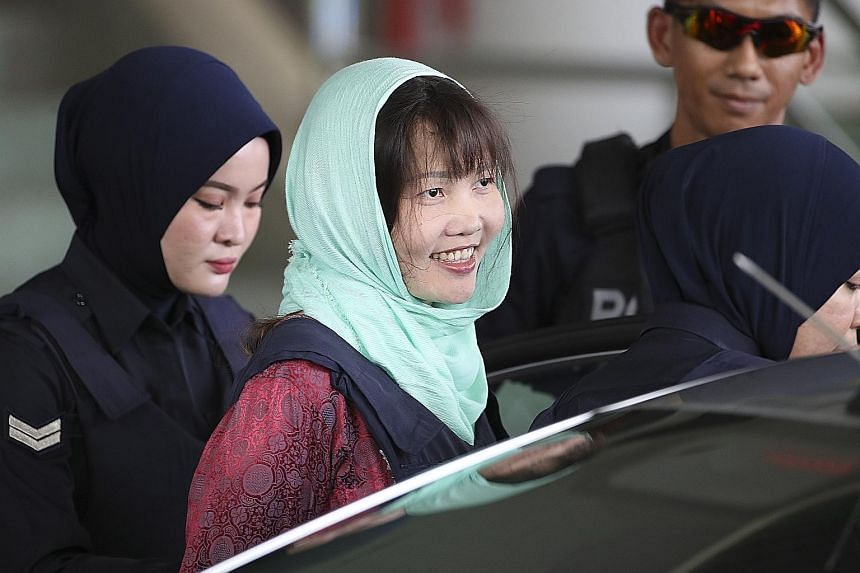 Vietnamese national Doan Thi Huong's father Doan Van Thanh outside the High Court in Shah Alam yesterday. Vietnamese national Doan Thi Huong is all smiles as she is escorted from the Shah Alam High Court after Malaysian prosecutors dropped the murder