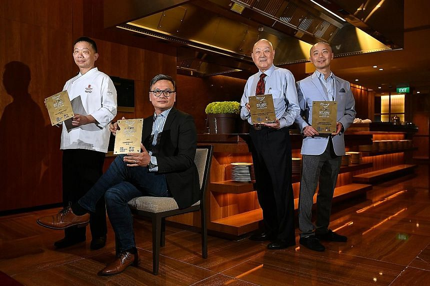 Gold award recipients at The Straits Times and Lianhe Zaobao's Best Asian Restaurants Awards (from left): master chef Chung Lap Fai of Hua Ting Restaurant; Chinese executive chef Cheung Siu Kong of Summer Pavilion; group operation manager Jimmy Leung