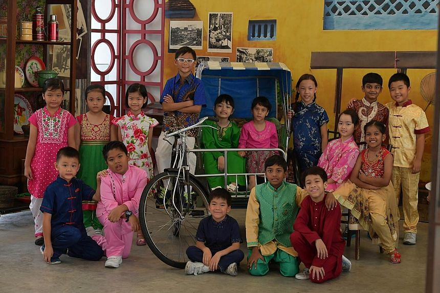 A file photo of pupils in various ethnic costumes in celebration of Singapore's diversity on Racial Harmony Day. The secularity Singapore adopts strives in every way possible to achieve racial and religious harmony. ST PHOTO: DESMOND FOO