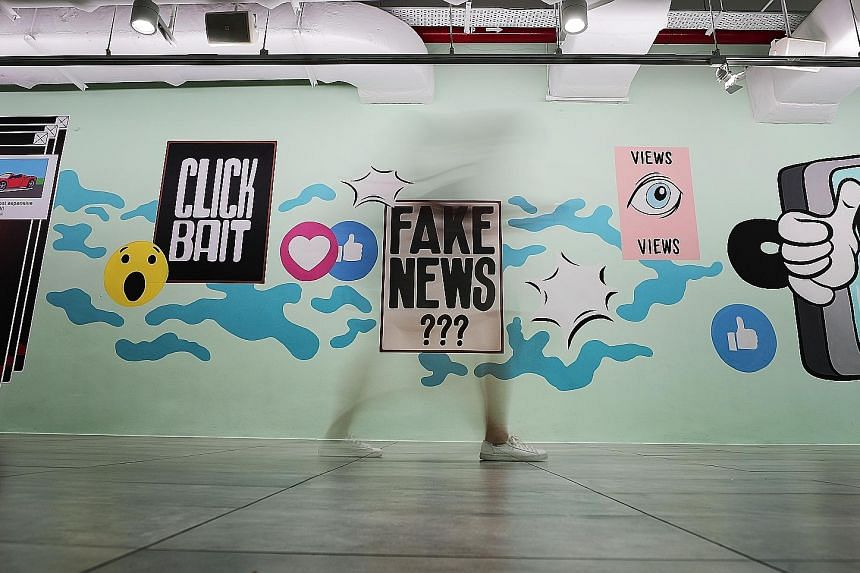 Graphics on the fake news issue in the underground pavement leading to the Esplanade last year. Law and Home Affairs Minister K. Shanmugam said leaving falsehoods to spread will crowd out legitimate debate.