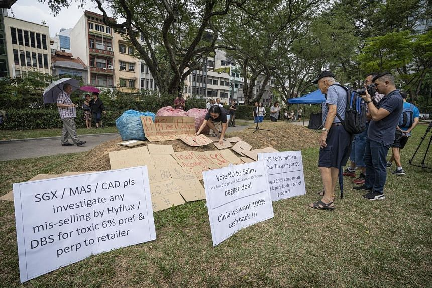 Signs laid out at the Speakers' Corner in Hong Lim Park last Saturday. The gathering drew hundreds, including many Hyflux investors. SM Investments had threatened to assert its right to yank its restructuring offer if certain conditions were not met,