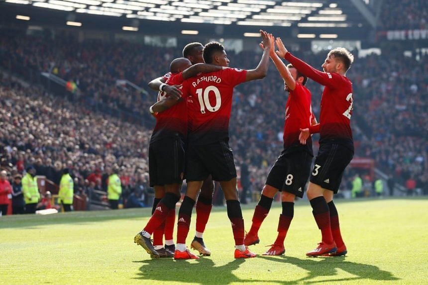 Manchester United players celebrate after scoring a goal against Watford, on March 30, 2019.
