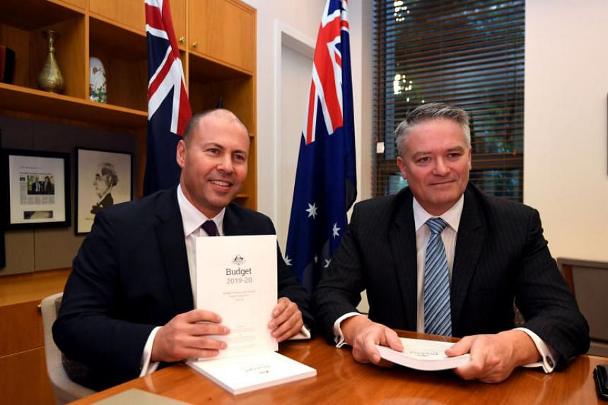 Australian treasurer Josh Frydenberg (left) poses for a photograph with Minister for Finance Mathias Cormann with the 2019 Budget papers ahead of Budget 2019 at Parliament House in Canberra.