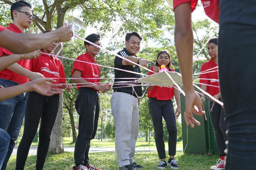 Mr Delane Lim (in black shirt) with trainers of the HappYouth programme. Mr Lim's story in The Straits Times' Generation Grit series made a 29-year-old man change his mind about ending his life in August 2018.