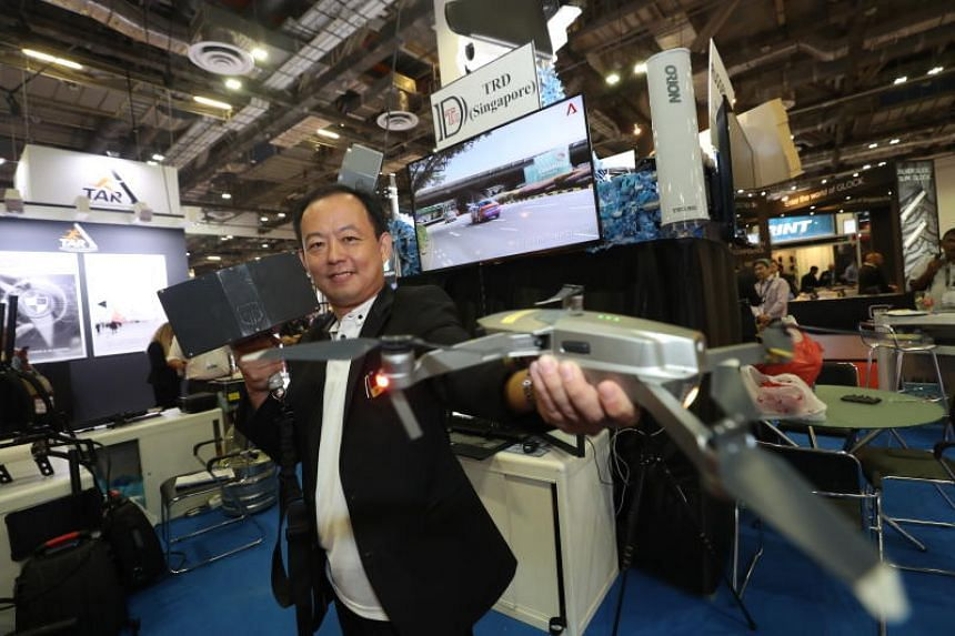 TRD Singapore managing director Sam Ong with a jammer and a drone at Milipol Asia-Pacific 2019.