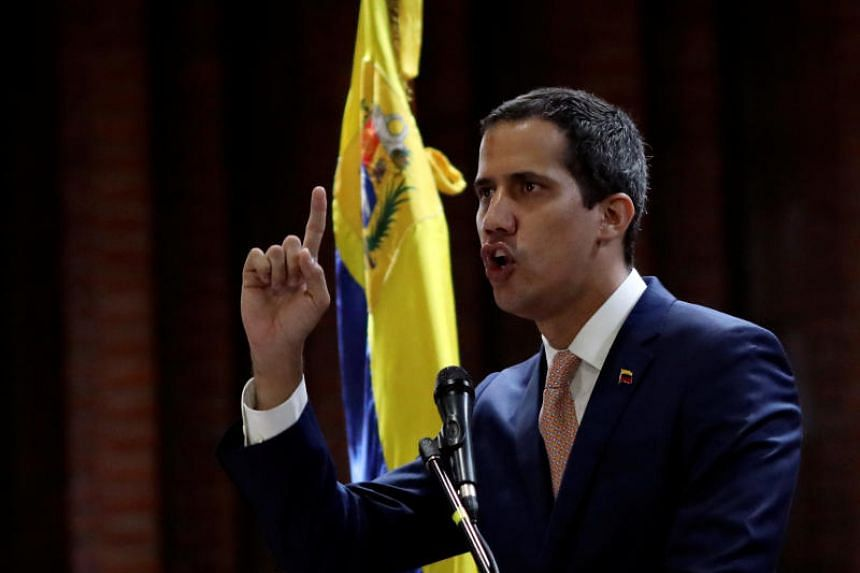 Venezuelan opposition leader Juan Guaido, who many nations have recognised as the country's rightful interim ruler, attends a meeting with political leaders at a university in Caracas, Venezuela, on April 1, 2019.