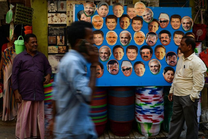 India is gearing up for the world's biggest election, with as many as 879 million eligible voters set to cast ballots starting on April 11. In Chennai, a shopkeeper displayed masks for political candidates.