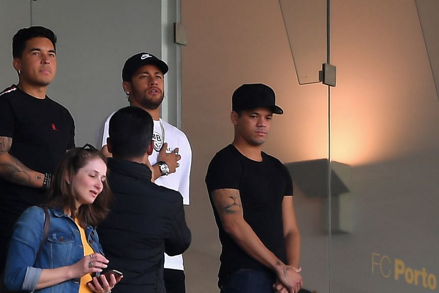 Neymar watches a friendly between Brazil and Panama in Porto, Portugal.