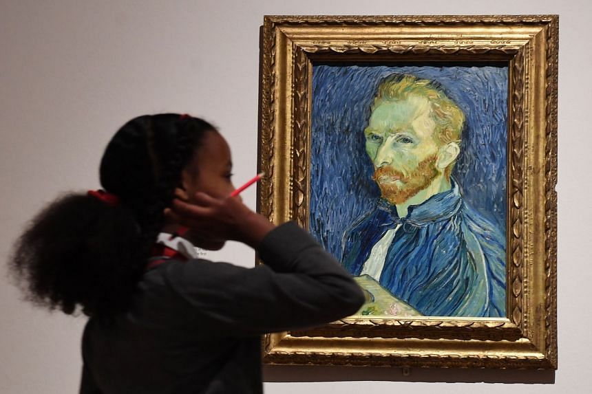 A schoolgirl looks at a self portrait by Vincent Van Gogh.