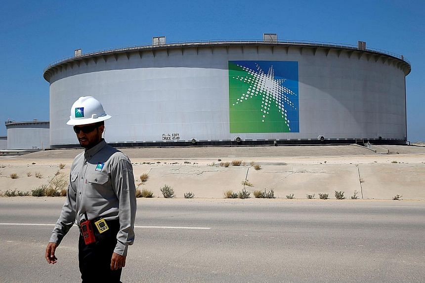 Saudi Aramco's Ras Tanura oil refinery and oil terminal in Saudi Arabia. The oil giant is set to borrow up to US$15 billion through a bond sale, in what could signal a more aggressive approach to capital raising for the company. The money will help f
