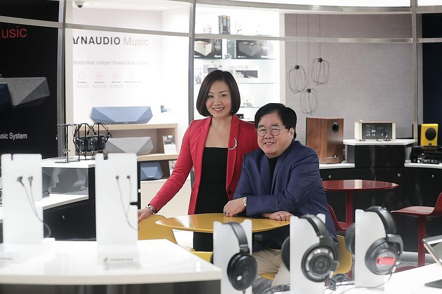 Challenger Technologies chief marketing officer Loo Pei Fen and chief executive Loo Leong Thye. The company said on March 20 that it intends to delist from the Singapore Exchange.