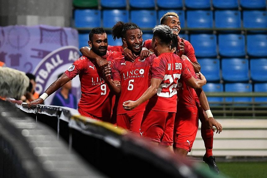 Home United players celebrate Abdil Qaiyyim's (No. 6) goal against Lao Toyota in their AFC Cup group tie. The defender's strike gave Home a 1-0 win, their first in the competition.