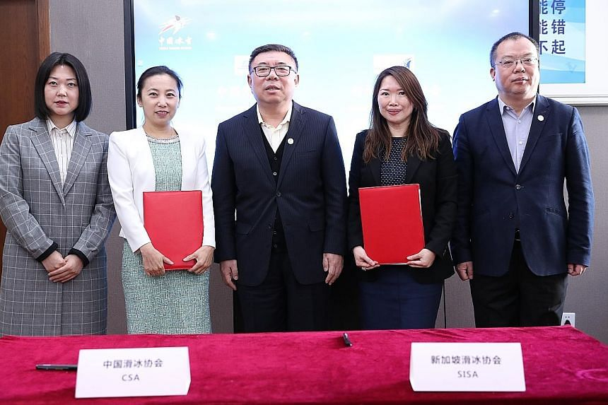 A three-year partnership between Sisa and CSA was signed in Beijing on Monday. Sisa honorary secretary Alicia Tan (second from right) with (from left) CSA vice-secretary-general Li Yanfeng, president Li Yan, Chinese Olympic Committee vice-president N
