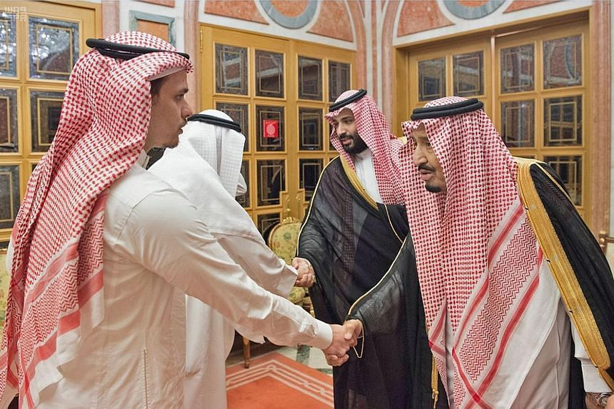 Journalist Jamal Khashoggi, who was killed in Istanbul last year, was targeted for articles that were often critical of the Saudi leadership. Saudi King Salman (front, right), with his son Crown Prince Mohammed Salman beside him, meeting family membe