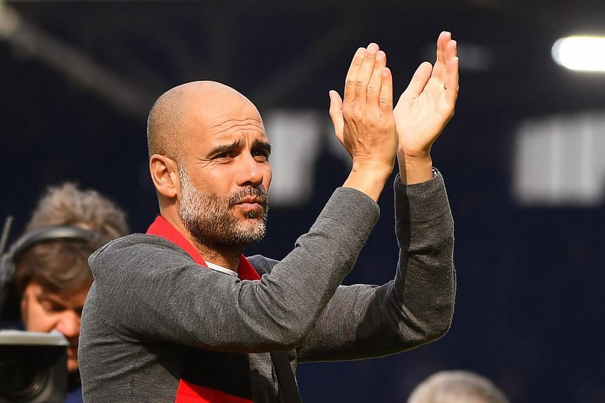 Manchester City manager Pep Guardiola applauds after winning the English Premier League soccer match between Fulham FC and Manchester City at Craven Cottage in London, Britain on March 30, 2019.