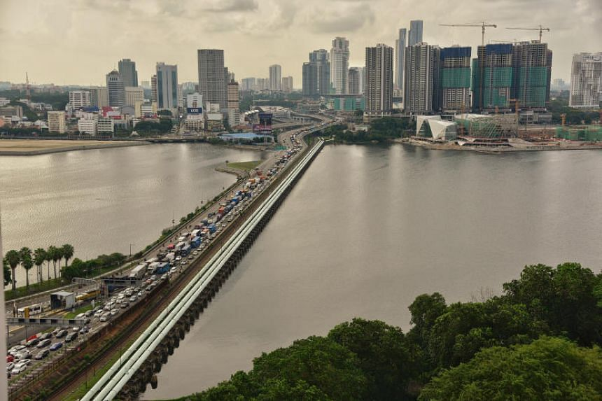 """The water pipeline along the length of the Causeway between Singapore and Malaysia. Referring to Singapore as Malaysia's """"neighbour down south"""", Water, Land and National Resources Minister Xavier Jayakumar said the daily water usage per capita for Ma"""