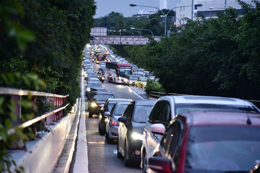 Vehicles at Singapore's Woodlands Checkpoint. Malaysian police have taken action against foreign motorists with outstanding fines in the past.