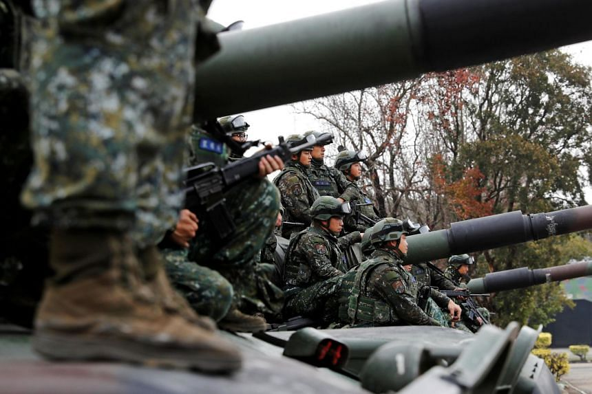 Taiwanese soldiers sit on a tank after an anti-invasion drill in January 2019. Taiwan scrambled aircraft following an incursion by Chinese jets on March 31.