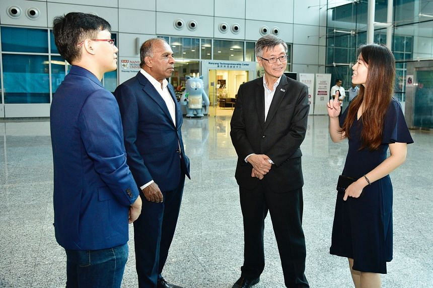 Interacting together after the signing ceremony of the collaborative exchange programme for PhD students held at the NTU Research Techno Plaza are (from left): PhD student Teng Ting Shien from Nanyang Technological University; Professor Subra Suresh,