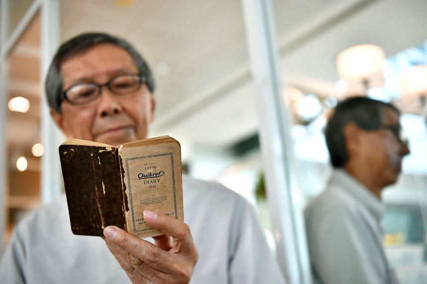 Mr Loh Kok Onn, 76, with his father's diary. It captured the colourful life that his father Loh Boon Thim had led in the last days of peace before the Japanese dropped bombs on Singapore in late 1941.