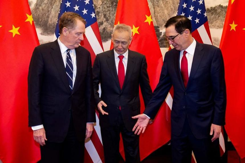 China's Vice Premier Liu He (C) gestures with US Treasury Secretary Steven Mnuchin (R) as US Trade Representative Robert Lighthizer (L) looks on as they pose for a photo at Diaoyutai State Guesthouse in Beijing on March 29, 2019. - Beijing said US an