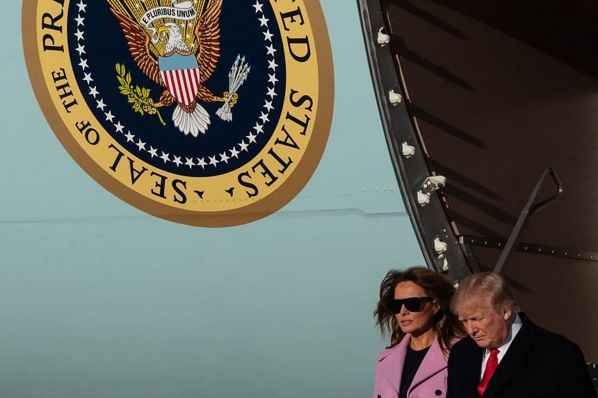 US President Donald Trump and First Lady Melania Trump returning from a weekend at his Mar-a-Lago estate in Florida.