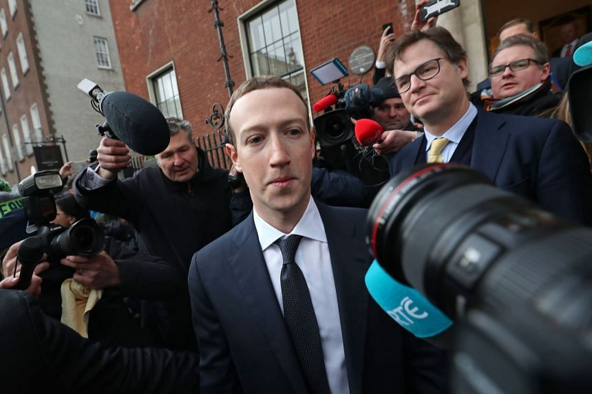 Zuckerberg (centre) leaves after a meeting in Ireland with politicians to discuss regulation of social media and harmful content.