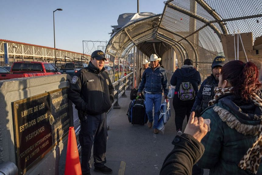 Border officers check travel documents on the Paso Del Norte Bridge, connecting the US and Mexico