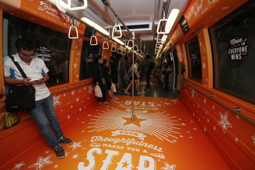 """One of six trains carrying the message """"Your thoughtfulness makes you a star"""", part of this year's Land Transport Authority campaign to promote courteous behaviour on buses and trains."""
