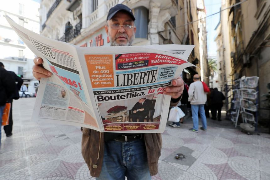 A man reading a newspaper in Algiers the day after Bouteflika submitted his resignation.