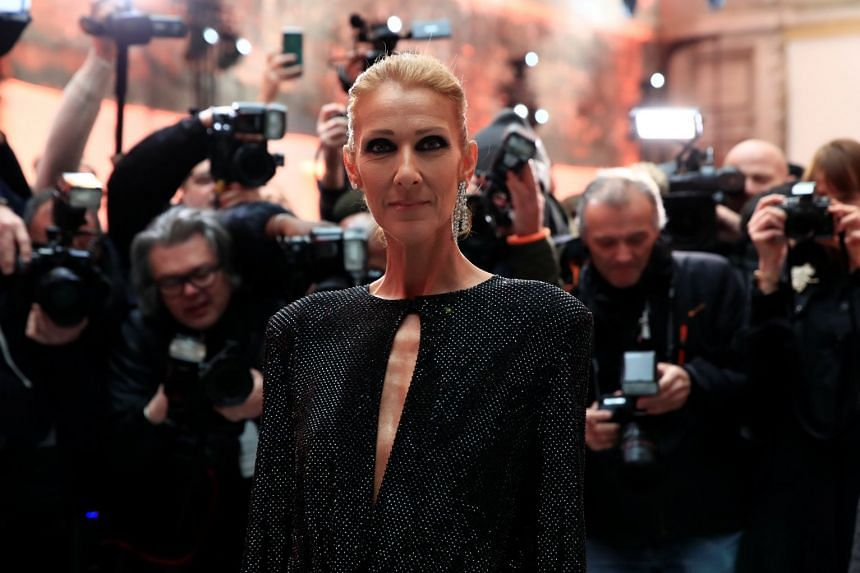 Celine Dion poses before a fashion show in Paris by designer Alexandre Vauthier, Jan 22, 2019.