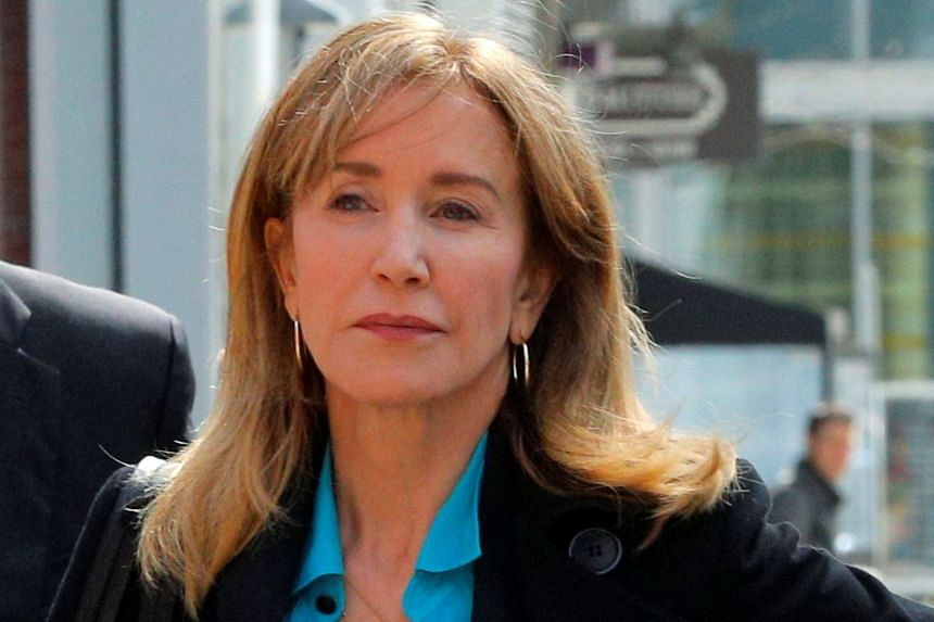 Felicity Huffman enters federal court in Boston, Massachusetts.