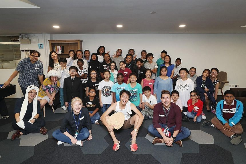 Beneficiaries of The Straits Times School Pocket Money Fund with Straits Times journalists during an outing at the ST newsroom on March 19.