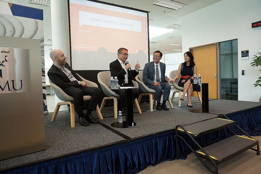 (From left) Singapore Management University (SMU) assistant professor of sociology Michael Genkin, Senior Minister of State for Law and Health Edwin Tong, SMU associate professor of law Eugene Tan and Singapore University of Technology and Design pro