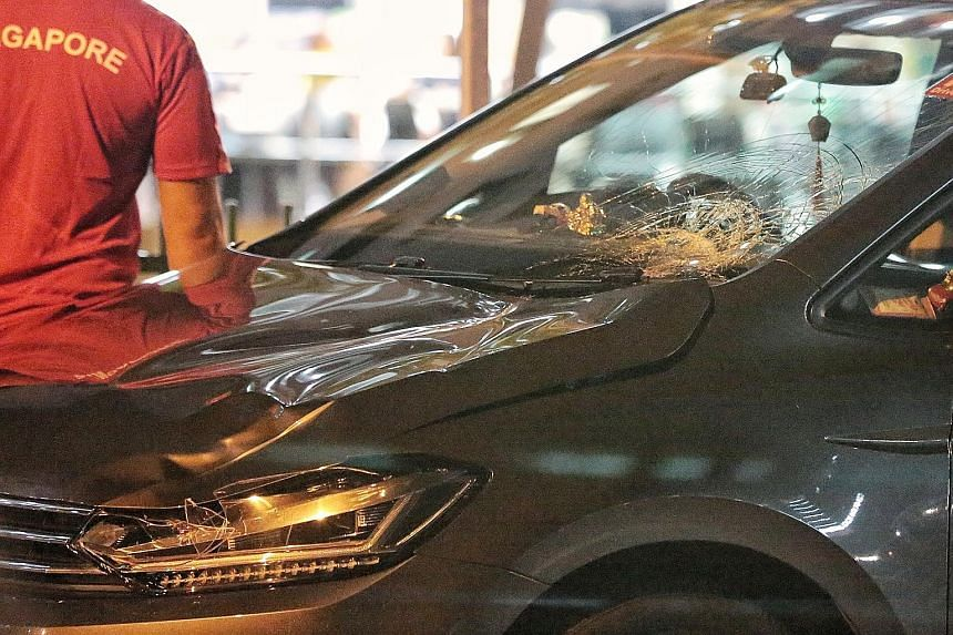 The impact from the collision damaged the front of the car. The driver has been arrested. PHOTO: SHIN MIN DAILY NEWS