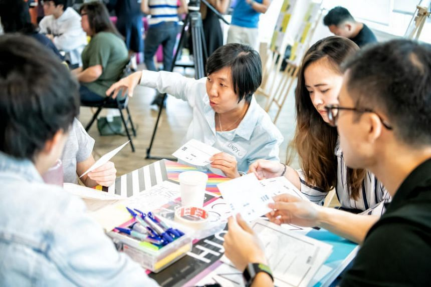Ms Cindy Chng facilitating a discussion with participants during a Youth Conversations session on the topic of success.