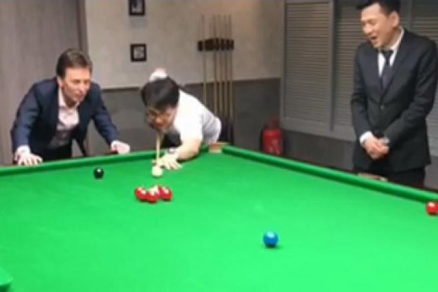 The video shows the action actor breaking the pink ball free from a circle of red balls and potting it in the side pocket.