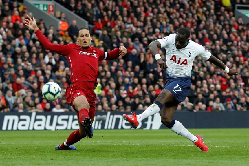 Liverpool's Virgil van Dijk (left) in action with Tottenham's Moussa Sissoko. The former has a growing reputation as one of the most influential figures in the Premier League title race between his side and Manchester City.